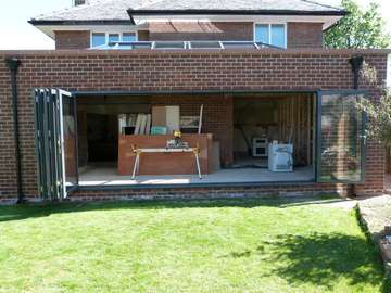 WEST DERBY , LIVERPOOL. Installation of Allstyle Alumnium Bi folding doors. Double glazed with Celsius clear , self cleaning double glazed units.