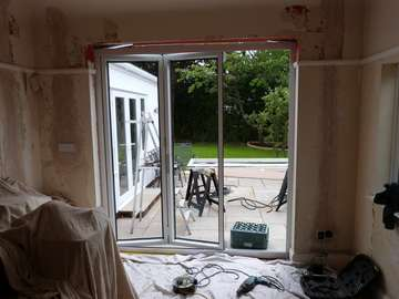 SALE , MANCHESTER. Biulding alteration , Including installing of lintels and plaster work to install Allstyle Polyester Powder Coated aluminium bi folding doors