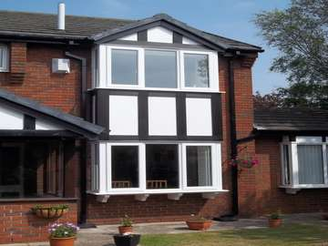 "Mr & Mrs C. West Kirby, Wirral. Installtion of our 2800 Dekko Bay windows, double glazed with ""A"" rated sealed units. NEW Tudour board cladding to match existing timber profiles- Foiled PvcU with white PvcU Infill panels"