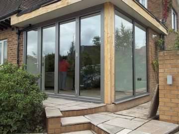 "Mr E : Garstang, Lancashire : Installtion of a Centor C1 Tripler Glazed Bi Fold door with a fixed frame sidelight in our ""Allstyle"" Thermally Broken window system"