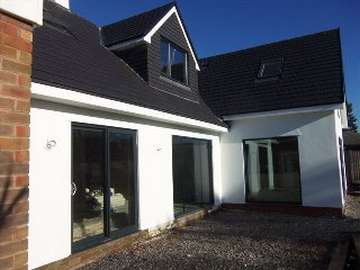 "Mickle trafford , cheshire : Self Build project : Instaltion of ""Allstyle"" alumnium Sliding Patio doors and windows, dual coloured in grey outside white in."