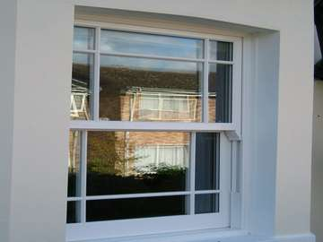 Formby Lancashire : Installation showing a Bygone White ash Upvc sliding sash window, showing features such as - run through Sash horns, Deep lower rail. Mortise joint fabrication