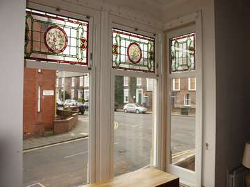 Mr D. : Northwich Cheshire. Installation of Bygone White foil sliding sash windows encapsulating original stained leaded lights