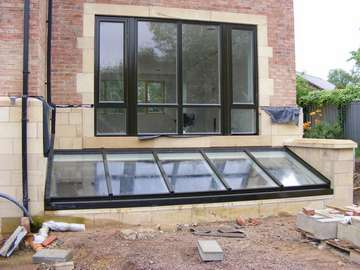 Newton Le Willows : Installation of HWL Thermally broken Aluminium Patent Glazing system. Polyester Powder coated in a Satin marine finish Ral 9017. Windows and doors S 300 Aluminium Profile
