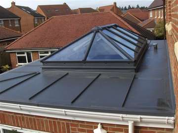 Mr & Mrs H. West Didsbury - Installtion of Sarnafil Roof covering with Lead Can look. Rooflight and windows. Rooflight - HWL Thermally broken roof stem double glazed with Celsius one - Ral to match roof covering