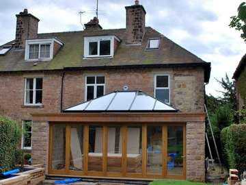 Cheadle Heath . Cheshire : Installation of HWL Roof Lantern with G. Barnsdale Timber Bi Fold doors.Skylight Painted to match Oak Bi Fold doors