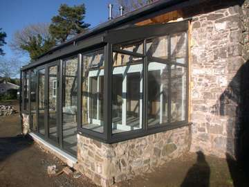 Mrs L. Cilcain North Wales : refurbishment . Installation of a HWl Ornate Thermally broken Aluminium Roof system glazed with Hytherm Clear units . Windows and doors Allstyle PP Coated Aluminium double glazed with Pilkington Activ K