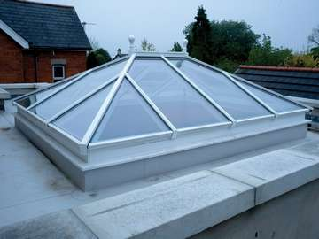Mr F. Crosby, Liverpool : Installtion of a ATS slim line Alumnium Roof Lantern. 45mm wide spars - double or triple glazed. Thermally broken Alumnium. Marine Finish Polester pwder coated to any RAL Colour