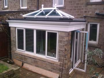 Doctor B. Hightown Cheshire: Design and build orangery with Slimline Bi folding doors, Celsius one roof glass constructed on a premier bespoke ornagery roof system