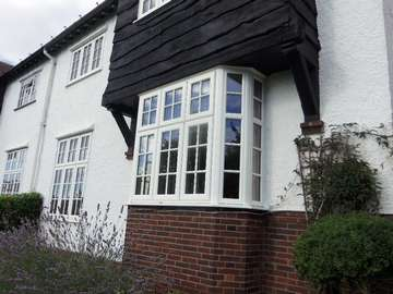 Mr & Mrs L. Lower Heswall Wirral : Installation of whitewood 2800 PvcU windows with astragal bar design design glass and Dummy vets to match the original timber windows Aluminium windows Formby Liverpool including Formby Bi folding doors