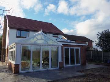 Greasby Wirral : Installation of Centor C1 Triple glazed Bi Fold doors U Value .75. - K2 PvcU Capped rooflight glazed with easy clean Celsius one sealed units U value 1. Conservatory : 2800 ststem White PvcU windows and doors TRIPLE Glazed U value .85 with K2 roof system glazed with Celsius One