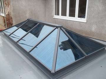 MR & MRS H HOYLAKE - HWL THERMALLY BROKEN ROOF LIGHT GLAZED WITH CELCIUS ONE GLASS RAL 7012. aluminium roof lantern on Wirral. High Quality - architecturally design - Aluminium lantern light near Caldy CH4 8QX - near West Kirby CH4 8QX - Near Heswall - Near Formby - Near Crosby - Near Liverpool Our Aluminium Powder coated roof lanterns can be found in any RAL colour in either 28mm argon filed double glazing or 44mm argon filed triple glazing. Our Aluminium Roof lanterns can be found on the Wirral in either West Kirby CH48, and Aluminium roof lanterns in Caldy CH48. Aluminium Roof lanterns can also be found in Liverpool in Formby, Crosby, Southport, Nearer to Manchester you can find our Aluminium Roof lanterns in Wilmslow, Alderly Edge and Nutsford. We have installed aluminium roof lanterns in Prestbury near Wilmslow. Aluminium Bi-fold doors have been largely demanded in Tarpoley.