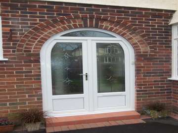 MR R UPTON WIRRAL - White PvcU Arched Door and frame with bespoke leaded lights design at home by JKG leadlighter. Upvc windows wirral
