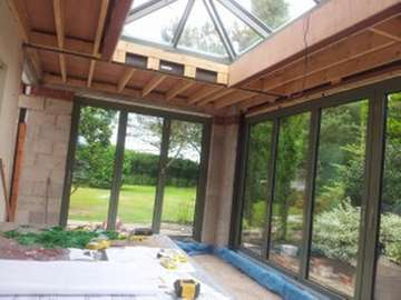 MR B, Alderley Edge: New build orangery extension with Centor C1 Bi-fold doors with 44mm triple glazing painted in with a marine finish (RAL 9017)with a 0.8 Uvalue and an ATS lantern roof light with 44mm triple glazing painted with a marine finish (RAL 9017). Example of aluminium triple glazed bi-fold doors. Aluminium bi-fold doors near Macclesfield SK11. Alumnus doors with 44mm triple glazing near Alderly Edge SK9. Aluminium Bi-fold doors near Wirral CH48 CH60. Alumnus Bi-fold doors triple glazed Liverpool Formby L37 near South Port PR8 Bi-fold doors near Crosby L23
