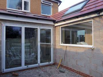 Mrs F. Heswall Wirral. : Installation of triple Glazed Centor C1 Bi Fold doors with Allstyle triple glazed fixed frame - standard white