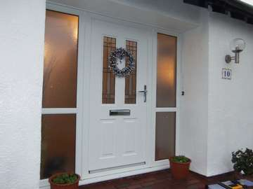 Bromborough Wirral : Installation of a Jacobean Aluminium Composite door with triple glazed side panels ; Decoration by others!